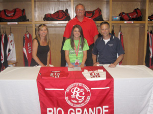 Twinsburg High's Nichole Mabry is flanked by her parents and Rio Grande coach David Smalley after signing with the RedStorm