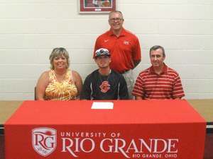 Kyle Miller poses with his parents and Rio Grande head baseball coach Brad Warnimont after signing to play for the RedStorm