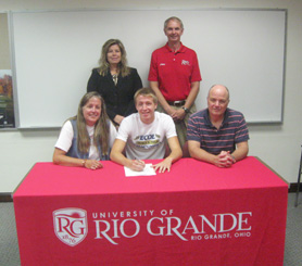 Dover High's Kyle Sanborn poses with family and coaches after signing to run at Rio Grande