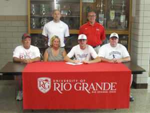 Southern High's Ryan Taylor is flanked by family and coaches after signing to play baseball at the University of Rio Grande