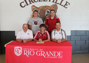 Circleville High's Connor Zingarelli poses with family and coaches after signing to play men's soccer at Rio Grande