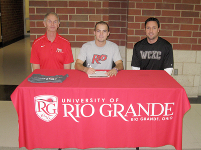 Westerville Central High's Dustin Edens is joined by Rio Grande head coach Bob Willey (left) and WCHS coach Jason Loughman