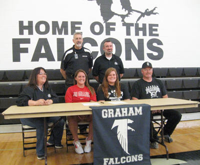 Family, coaches and administrators watch as Graham High's Rachel Foster signs with Rio