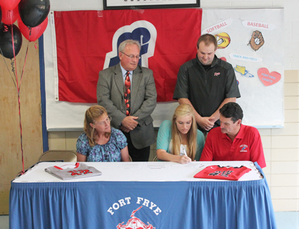 Fort Frye High School's Megan Liedtke is joined by her parents and Rio coaches as she signs with the RedStorm