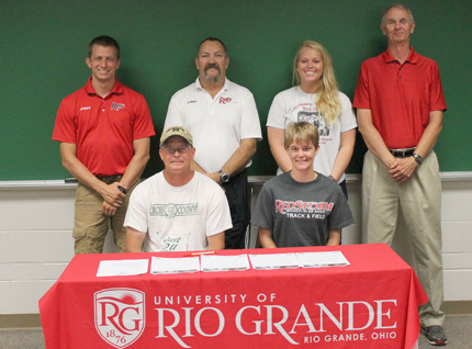Ohio Virtual Academy's Tyanna Petty is joined by her father and coaches as she signs with Rio Grande
