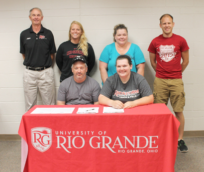 Carrollton High grad April Sisk is joined by family and coaches as she prepares to sign with Rio Grande