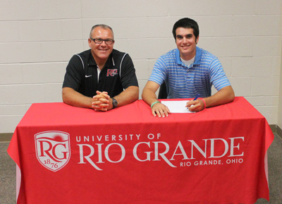 Dublin Coffman High's Dominic Tiberi poses with Rio Grande baseball coach Brad Warnimont after signing with the RedStorm
