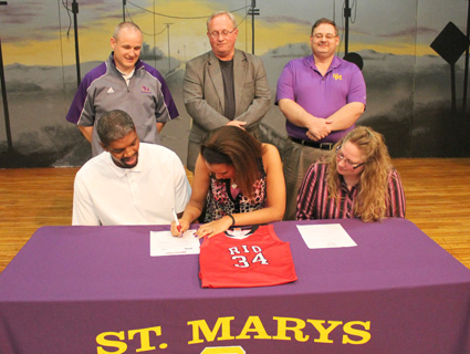 St. Marys High's Kendra Walker is joined by family and coaches as she signs with Rio Grande