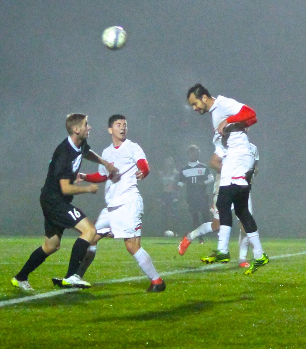 Rio's Heitor de Melo heads a ball forward through the fog during Wednesday night's win over Union