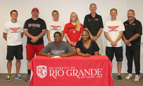 Georgetown High's Bruce-Derrick Williams is joined by his aunt, Beverly, and Rio Grande coaches as he signs with the Redstorm