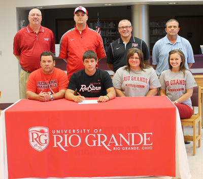 Family and coaches join Northwest High's Flip Cassidy as he signs with Rio Grande