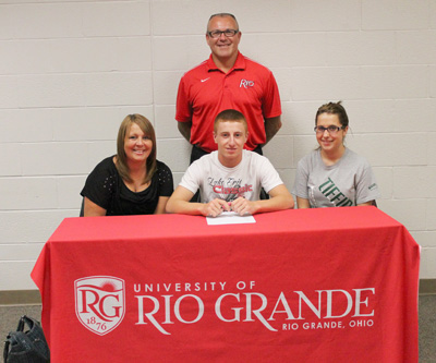 Clyde High graduate Brett Combs is joined by family members and Rio coach Brad Warnimont as he signs with the RedStorm