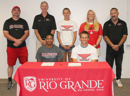 Cosby High School grad Brendon Crawley poses with Rio Grande coaches as he sets to sign with the RedStorm