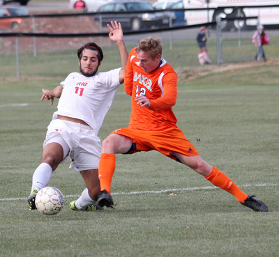 Rio's Alex Haddad battles Baker's Preston Phillips for control of the ball during Saturday's NAIA tourney game