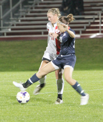 Rio's Rachel Hoffman battles for control of the ball during Tuesday night's loss to Cumberlands
