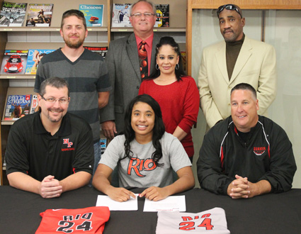 New Philadelphia High's Jaida Carter is joined by family and coaches as she signs to play collegiately at Rio Grande