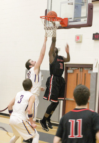 Rio's D.D. Joiner scores two of his game-high 31 points during the second half of Saturday's win at Carlow