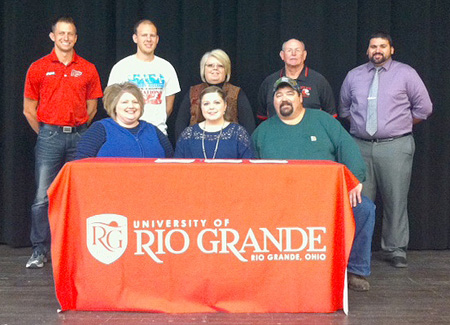 South Gallia's Alexis Johnson is joined by family, coaches and administrators as she signs with Rio Grande