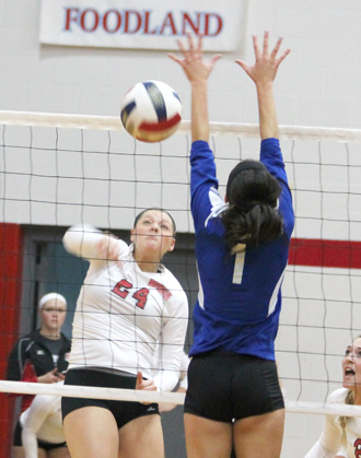 Rio's Aleah Pelphrey rifles a kill past Brescia's Rhiannon Ungerer during Friday night's win