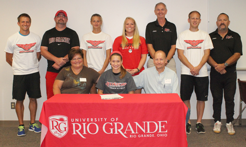 Williamsburg's Caley Pringle poses with her parents and Rio Grande coaches before signing with the RedStorm