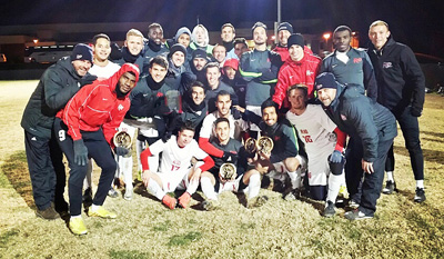 The Rio Grande men's soccer team, shown here after winning the KIAC tourney title, hosts Baker University on Saturday