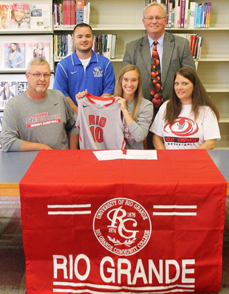 Gallia Academy's Chelsy Slone is joined by family and coaches as she signs to play at Rio Grande