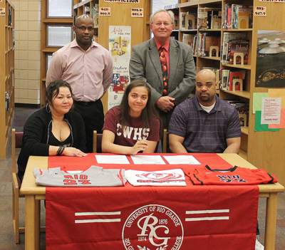 Canal Winchester's Jasmine Smith is joined by coaches and family as she signs to play at Rio Grande