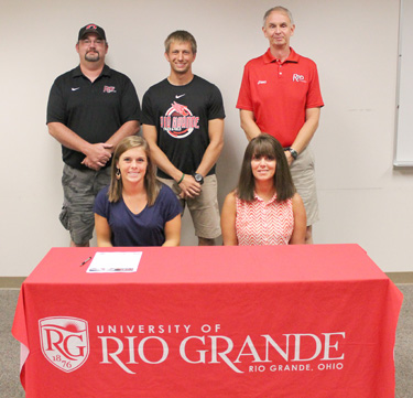 Gallia Academy's Breanna West is joined by her mother and Rio coaches before signing with the RedStorm