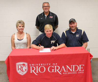 Teays Valley High's Dalton Wilburn is joined by his parents and Rio coach Brad Warnimont as he sets to sign with the RedStorm