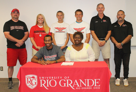 Mount Healthy High's Cinque Williams is joined by his mother and Rio Grande coaches as he sets to sign with the RedStorm