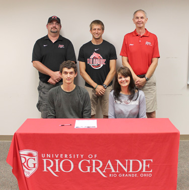 Greenville High's Aaron Wise is joined by his mother and Rio coaches before signing with the RedStorm