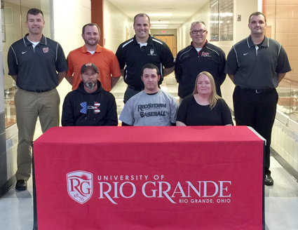 Wheelersburg High baseball standout Zach Russell is joined by family and coaches as he signs with Rio Grande