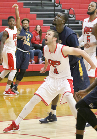 Rio Grande's Corey Cruse tries to get rebounding position during the first half of Thursday night's loss to WVU Tech