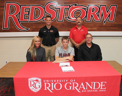 New Philadelphia High's Brody Ferry is joined by his parents and Rio coaches as he signs with the RedStorm