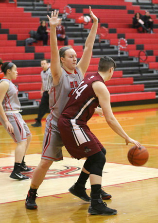 Rio's Harley Adler guards IU-Southeast's Jocelyn Mousty during the first half of Wednesday's KIAC tourney game