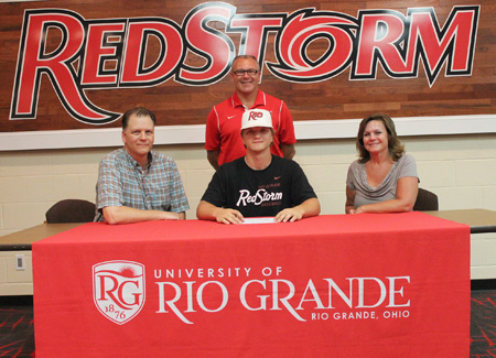 Granville High School's Graham Parsley is joined by his parents and Rio coach Brad Warnimont as he signs with the RedStorm