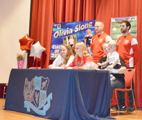 Spring Valley High School's Olivia Slone is joined by family and coaches as she signs to play soccer at Rio Grande