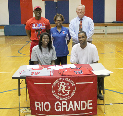 JFK High 's Daijha Truett is joined by her father, Antoine, school administrators and coaches as she signs with Rio Grande