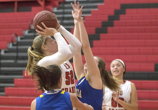 Rio's Brooke Marcum puts in two of her 10 points in Friday's 78-68 win over Brescia. She surpassed the 1,000-point mark for h