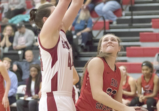 Rio's Kamryn Conaway tries to put up a shot around IU Southeast's Jocelyn Mousty during Saturday's 90-63 victory