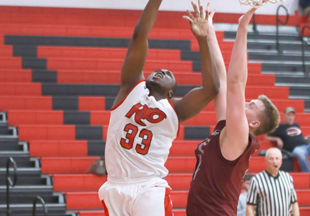 Rio's Abe Eze battles IU East's Nate Niehoff for a rebound during Tuesday night's double overtime loss to the Red Wolves