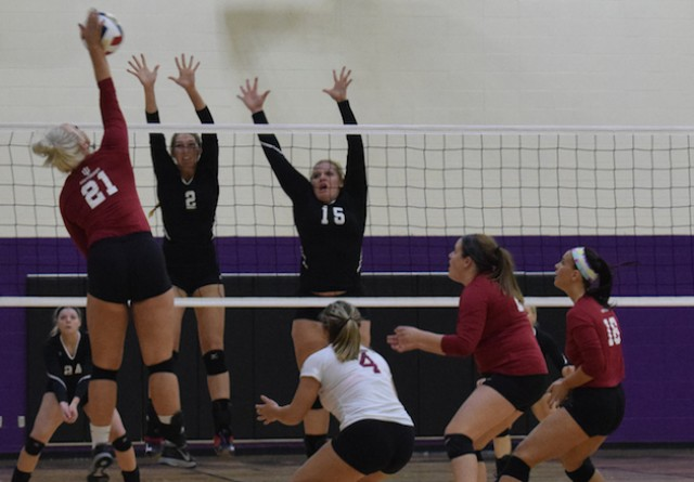 Rio's Kayla Briley (2) and Rachael Gilkey (15) attempt to block IU Southeast's Hannah Joly in Friday's RSC quarterfinal