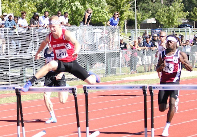 Rio Grande's Clint Campbell runs to a school-record finish during Thursday's 400-meter hurdle time trials at the NAIA Nationa