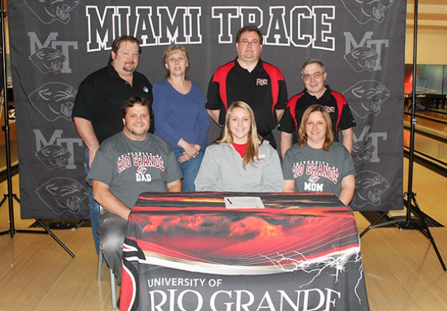 Miami Trace High School's Macy Detty is joined by family and coaches as she signs to bowl at the University of Rio Grande