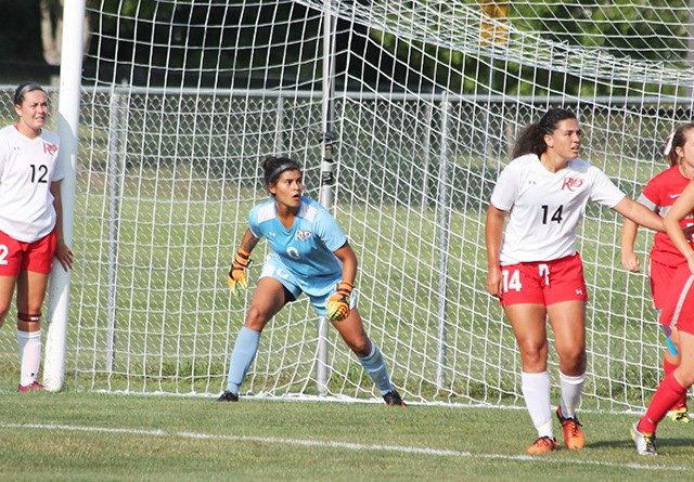 Rio Grande keeper Andrea Vera watches the flight of a corner kick during Friday's loss to Indiana Wesleyan