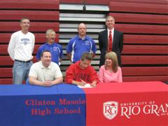 Clinton-Massie standout Myles Corcoran signs his national letter of intent to run track and cross country for Rio Grande