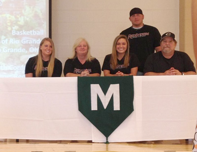 Mason High School's Aly Herren is joined by family members for a photo after signing to play basketball at Rio Grande