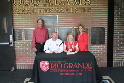 Xenia High's Laurel Amstutz poses with her parents and Rio Grande coach Callum Morris after signing with the RedStorm