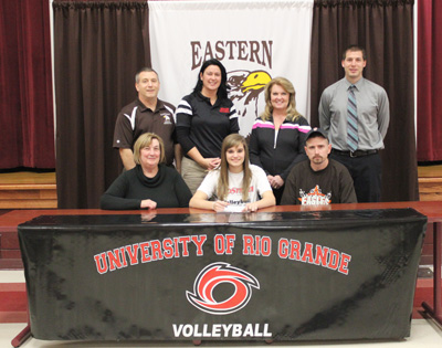 Eastern High's Miranda Clark poses with family, coaches and administrators after signing to play at Rio Grande