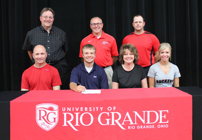 Oak Hill High's Drew Haislop poses with family, coaches and administrators after signing with Rio Grande